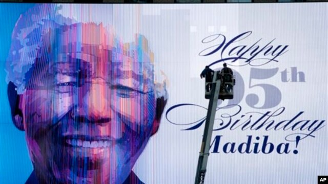 An electronic billboard announces Nelson Mandela's 95th birthday in Times Square, New York, July 18, 2013.