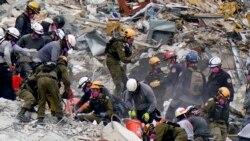 來自美國和以色列的人員在佛羅里達瑟夫塞德倒塌的大樓廢墟進行搜救。(2021年6月29日)
