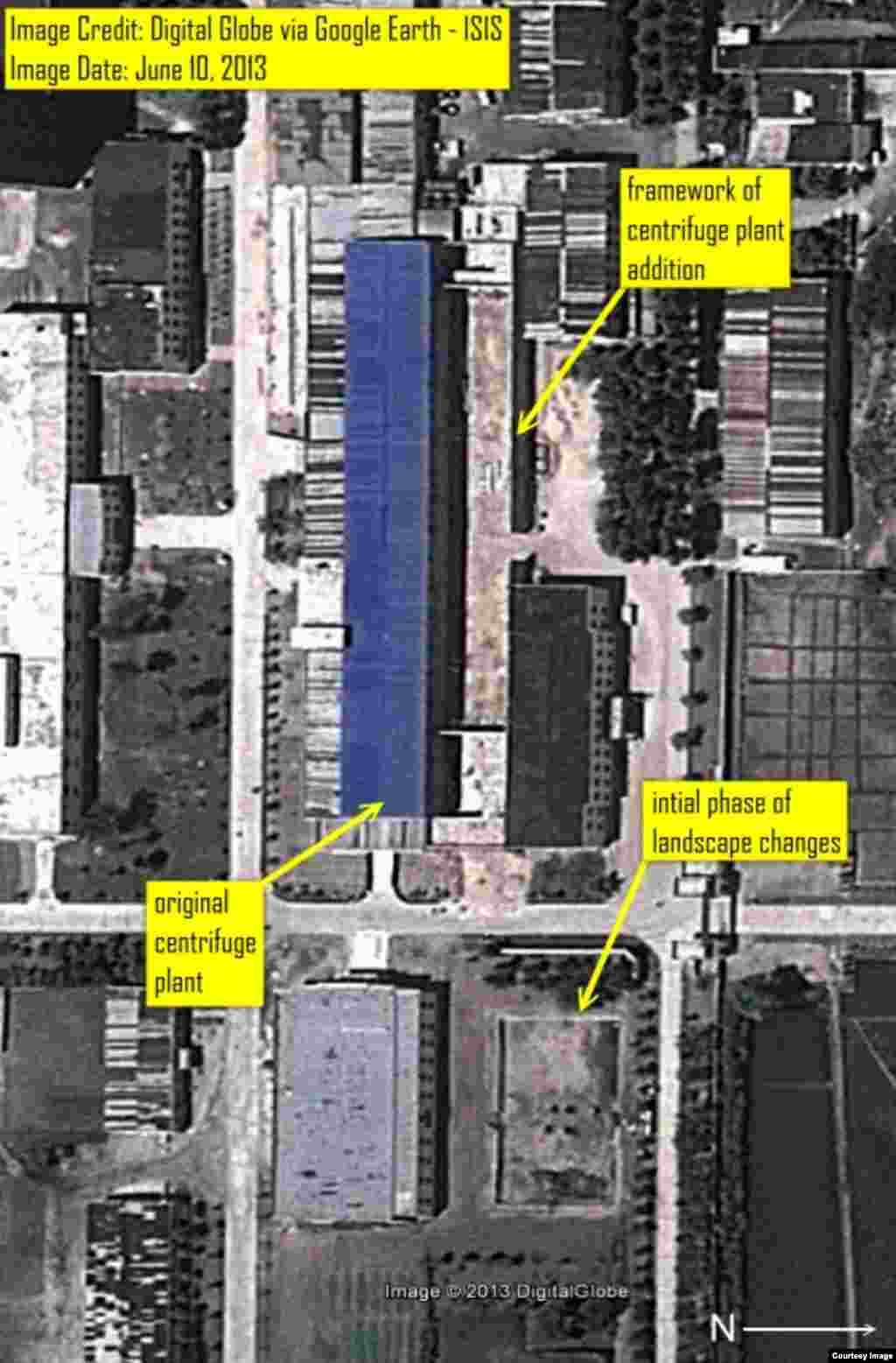 Digital Globe imagery from June 10, 2013 available on Google Earth showing the frame of the extension added to the centrifuge plant building.