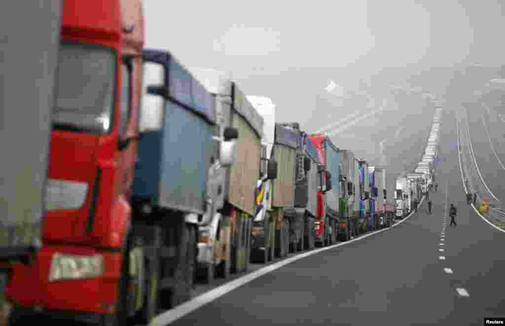 Trucks are seen on a highway near the Kulata border crossing between Bulgaria and Greece. Bulgarian truckers staged a counter-blockade at a checkpoint on the country's border with Greece, after Greek protesters failed to keep a promise to lift their own blockade for a few hours a day.