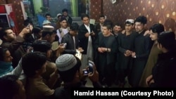 Hamid Hassan is surrounded by fans in Kandahar city, a stronghold of Taliban militants.