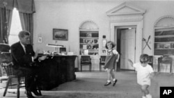 John Kennedy and his children in the Oval Office at the White House in 1962.