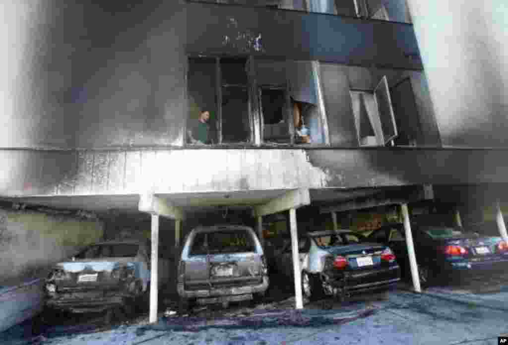 An investigator works where fire caused damage to an apartment in Hollywood on December 30, 2011. (AP)