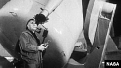 Edwin Hubble looks through a guidescope of the 1.2 meter telescope at the Palomar Observatory in California.