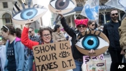 Demonstrators participate in a march and rally to demand President Donald Trump release his tax returns, April 15, 2017, in New York.
