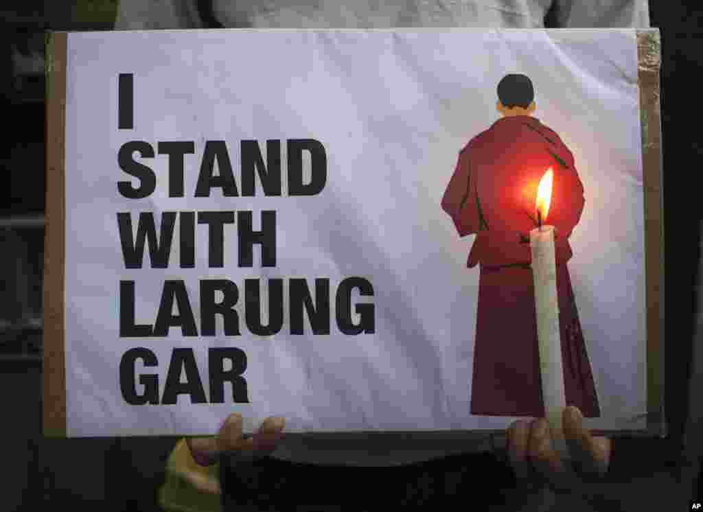 An exiled Tibetan holds a sign as he participates in a protest in Dharmsala, India, against the demolition of buildings in Larung Gar by Chinese authorities. Larun Gar is an area in eastern Tibet housing Buddhist institutions and thousands of monks and nuns.