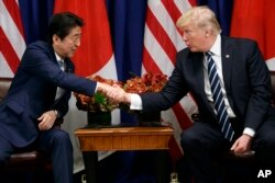 President Donald Trump shakes hands with Japanese Prime Minister Shinzo Abe during a meeting at the Palace Hotel during the United Nations General Assembly, Thursday, Sept. 21, 2017, in New York.