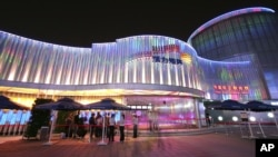 The China Private Enterprise Pavilion is seen at night at the Shanghai World Expo Monday May 3, 2010 in Shanghai, China.