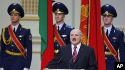 Belarus's President Alexander Lukashenko takes his oath of office during his inauguration ceremony in Minsk, January 21, 2011
