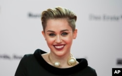 Singer Miley Cyrus arrives for the Bambi 2013 media awards in Berlin, Germany, Nov. 14, 2013.