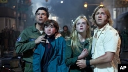 Left to right: Kyle Chandler plays Jackson Lanb, Joel Courtney plays Joe Lamb, Elle Fanning plays Alice Dainard and Ron Eldard plays Louis Dainard in SUPER 8, from Paramount Pictures.