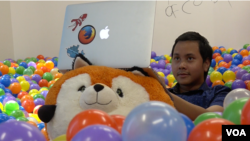 Farishki Vidyan hangs out in the ball pit at Mozilla in Silicon Valley.