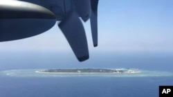 FILE - In this March 23, 2016, file photo, an aerial view is seen from a military plane carrying international journalists of the Taiwan-controlled Taiping island, also known as Itu Aba, in the Spratly archipelago, roughly 1600 kms. (1000 miles) in the So