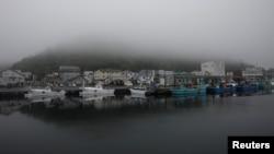 A heavy shroud of morning mist fills a port in Rausu, Hokkaido, Japan, July 2, 2019. (Reuters)