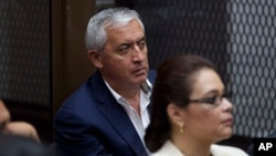 FILE - Guatemala's former President Otto Perez Molina, and his former Vice-President Roxana Baldetti, listen during their court hearing in Guatemala City, May 6, 2016. Twenty-three people were arrested Thursday on charges related to the alleged illegal financing of the political party that carried Perez Molina to power, Guatemalan authorities said.