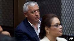 FILE - Guatemala's former President Otto Perez Molina, and his former Vice President Roxana Baldetti, listen during their court hearing in Guatemala City, May 6, 2016.