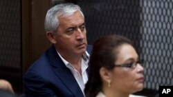 FILE - Former Guatemalan President Otto Perez Molina and his former vice president, Roxanna Baldetti, listen during a court hearing in Guatemala City, May 6, 2016. Twenty-three people had been arrested on charges related to the alleged illegal financing of the political party that carried Perez Molina to power, Guatemalan authorities said.