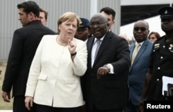 FILE - German Chancellor Angela Merkel is welcomed by Ghana's Vice President Bawumia at the Jubilee Airport in Accra, Ghana, Aug. 30, 2018.