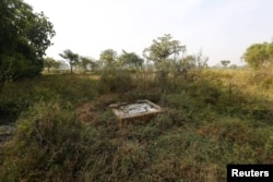 FILE - An open toilet is seen in a field in Gorba in the eastern Indian state of Chhattisgarh, India, Nov. 16, 2015.