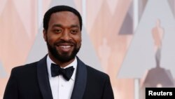 "FILE - Actor Chiwetel Ejiofor, shown at the 87th Academy Awards in Hollywood, California, Feb. 22, 2015, was among the big names in the newly released video ""What They Took With Them."""