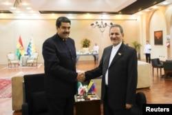 Venezuela's President Nicolas Maduro (L) shakes hands with Iran's Vice President Eshaq Jahangiri as they meet during the 4th Gas Exporting Countries Forum in Santa Cruz, Bolivia, Nov. 24, 2017.