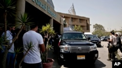 Mexico's Secretary of Foreign Relations Claudia Ruiz Massieu leaves in her vehicle after her visit to injured Mexican tourists at the Dar Al Fouad Hospital in Cairo, Egypt, Wednesday, Sept. 16, 2015.
