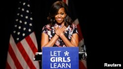 FILE - U.S. first lady Michelle Obama speaks to pupils during a visit to Mulberry school for girls in London, June 16, 2015.
