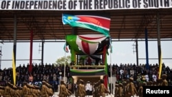 Members of the Sudan People's Liberation Army (SPLA) march during celebrations to mark the first anniversary of South Sudan's independence in Juba, July 9, 2012. South Sudanese celebrating their nation's first birthday on Monday will bask in the pride of