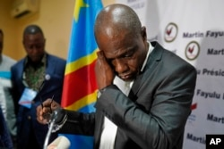 Opposition candidate Martin Fayulu wipes his face before speaking to the press at his headquarters in Kinshasa, DRC, Jan. 10, 2019. Fayulu, who came second in the presidential poll behind Felix Tshisekedi, called the results fraudulent.