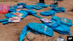 Children's backpacks lie at the site a day after an airstrike in Saada, Yemen, Aug. 10, 2018.