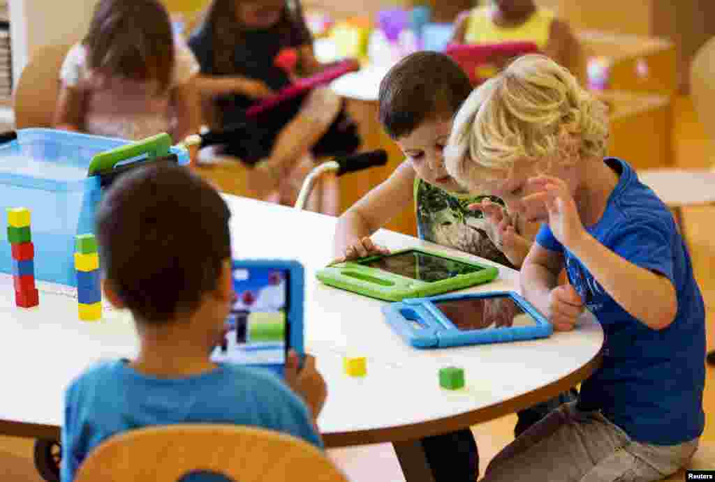 Students play with their iPads at the Steve Jobs school in Sneek. The Steve Jobs schools in the Netherlands are founded by the O4NT (Education For A New Time) organization, which provides the children with iPads to help them learn with a more interactive experience.