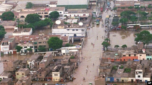 FILE - A panoramic view shows a highway flooded by heavy rains southeast of Lima, Peru, Jan. 30, 1998. This past week, the country has been hit by heat and rain extremes at levels not seen in two decades.
