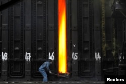 FILE - A man works at Turkish steel manufacturer ISDEMIR's plant in Iskenderun in Hatay province, Turkey.