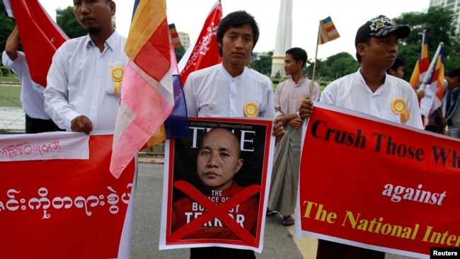 FILE - People demonstrate against Time magazine in Yangon June 30, 2013 when its cover story dubbed radical Buddhist monk U Wirathu,