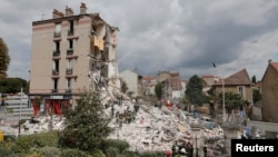 A four-story building was rocked by an explosion and collapsed in a northeastern suburb of Paris on Sunday, Aug. 31, 2014.