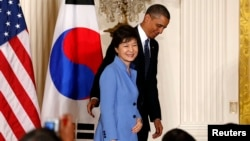 U.S. President Barack Obama and South Korea's President Park Geun-hye depart a joint news conference in the East Room of the White House in Washington, May 7, 2013.