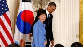 U.S. President Barack Obama and South Korea's President Park Geun-hye depart a joint news conference at the White House in Washington, May 7, 2013.
