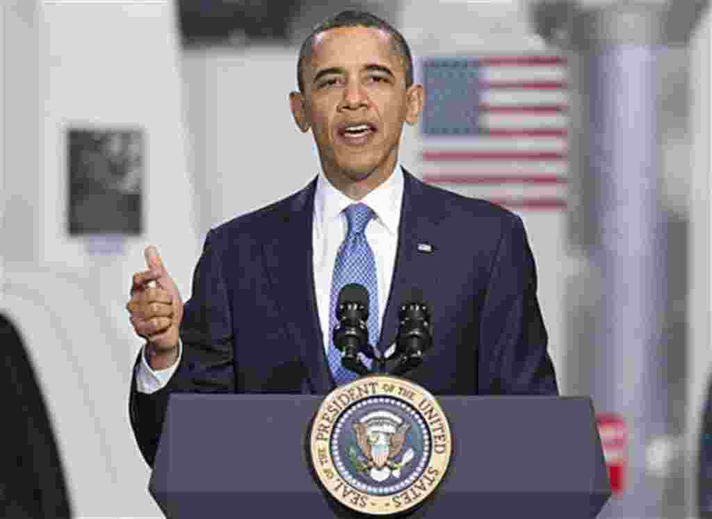 President Barack Obama gestures while speaking at a UPS facility in Landover, Maryland, April 1, 2011