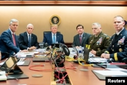 U.S. President Donald Trump, U.S. Vice President Mike Pence (2nd L), U.S. Secretary of Defense Mark Esper (3rd R), along with members of the national security team, watch as U.S. Special Operations forces close in on ISIS leader Abu Bakr al-Baghdadi.