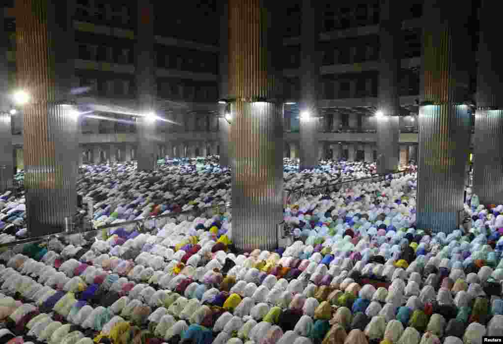 "Muslims attend an evening mass prayer session called ""tarawih"" to mark the holy fasting month of Ramadan at Istiqlal Mosque in Jakarta, Indonesia, June 28, 2014."