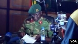 Colonel Everson Mugwisi addressing journalists in Harare on Wednesday.