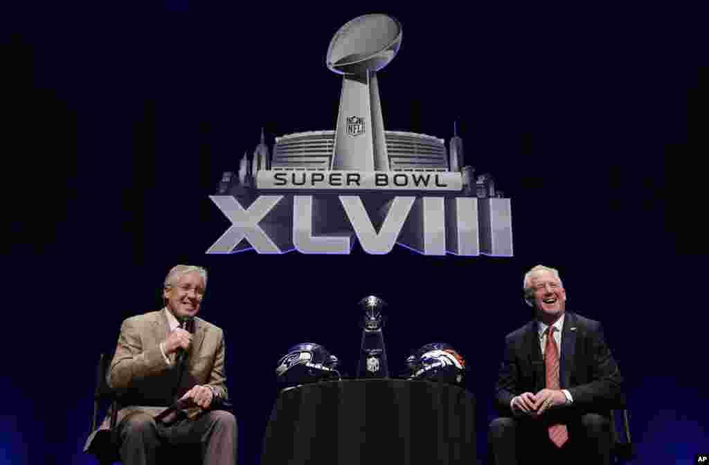 Seattle Seahawks head coach Pete Carroll and Denver Broncos head coach John Fox speak at a news conference, Jan. 31, 2014, in New York.