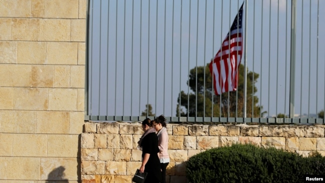 FILE - People walk past the U.S. Consulate in Jerusalem, Feb. 24, 2018. The consulate has been closed since 2019.