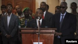 UN special envoy for Somalia Augustine Mahiga. center (file photo, AU-UN via Reuters).