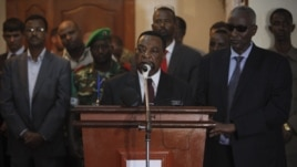 UN special envoy for Somalia Augustine Mahiga. center (file photo, AU-UN via Reuters).