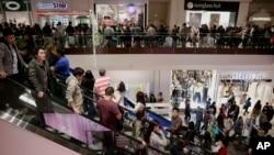 FILE - Shoppers in Brea Mall in Brea, California.