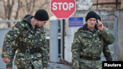 Ukrainian soldiers outside the Ukrainian infantry base in Perevalne, Ukraine, March 12, 2014.
