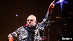 Greek singer Demis Roussos performs at the Edineyat international festival in Ehden town, northern Lebanon, Aug. 10, 2013.