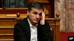 Greek Finance Minister Euclid Tsakalotos attends a parliamentary session in Athens, Dec. 5, 2015.