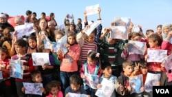 Zarokên Efrînî yên penaber daxwaza vegera malên xwe dkin